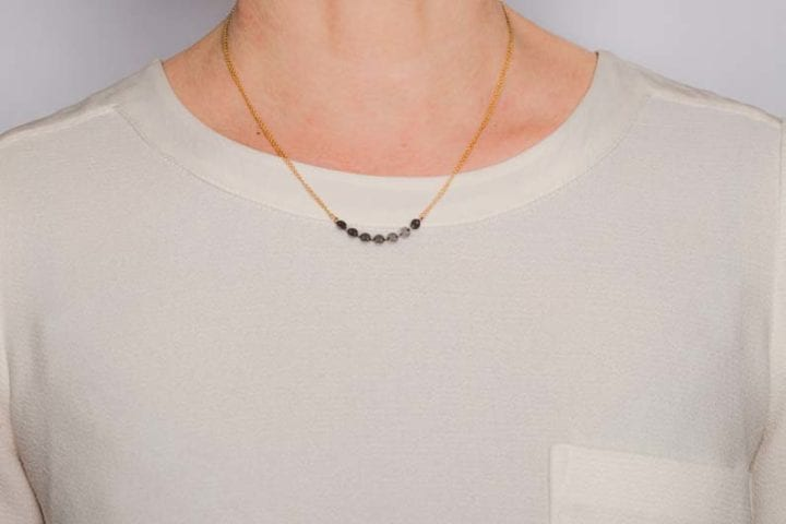 delicate disc necklace on model